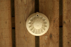 Smoke detector. On wooden background Stock Photos