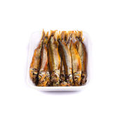Smoke-dried anchovies in plate close up. Stock Photos