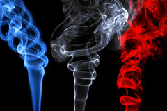 Smoke effects that represent the French flag stock photos