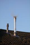Smoke emerging from aluminum chimney Royalty Free Stock Photo