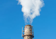 Smoke emission from factory pipe Stock Photos
