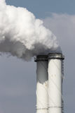 Smoke emission from factory pipes Stock Photography