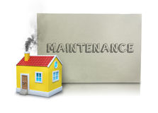 Smoke Emitting From Model Home By Maintenance Placard. Digital composite image of smoke emitting from model home chimney by maintenance placard against white Royalty Free Stock Photography
