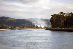 Smoke in a estuary Stock Images