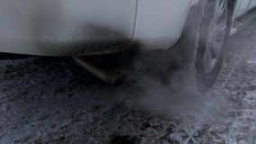 The smoke and exhaust fumes coming from the exhaust pipe of a  car stock video