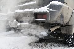 Smoke from the exhaust pipe. Of the car. White exhaust on a frosty day Royalty Free Stock Photos