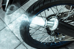 Smoke from exhaust tube of a motorcycle,filter effect,selected f Stock Images