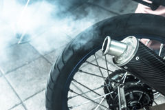 Smoke from exhaust tube of a motorcycle,filter effect,selected f Royalty Free Stock Photo