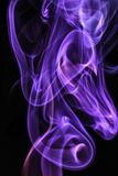 Smoke, through extreme bends, flowing up, colorful. Smoke, flowing through bends, creating amazing backdrops with colorful highlights on a black canvas Stock Photography