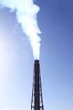 Smoke from a factory stack. Smoke from a factory in a blue sky Royalty Free Stock Image