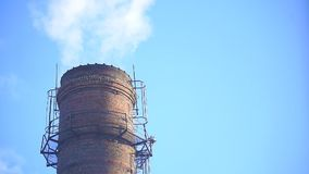 Smoke From the factory chimney. Against the blue sky stock video