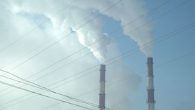 Smoke from a factory chimney. The smoke from a factory chimney stock video footage