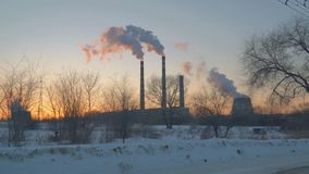 Smoke from factory chimneys. On background of sunset sky stock video