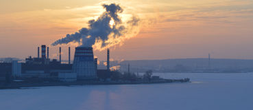 Smoke from factory chimneys at sunset Stock Images