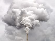 Smoke from factory pipe against overcast sky. Smoke from factory pipe against dark overcast sky Stock Photos