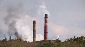 Smoke of factory pipes .Global environmental problem of air and nature pollution by industries plants.