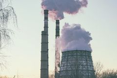 Smoke from factory pipes. Against the sky. Environmental pollution Stock Photography