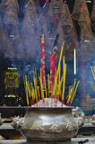 Smoke filled chinese temple. Burning incense sticks at the Thien Hau temple in Ho-Chi-Minh City, Vietnam Stock Image