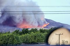 Smoke-filled misery, Southern California Fires still burning. Natural disaster. Moving car, smoke trail in background royalty free stock photography