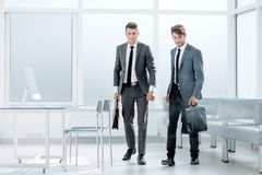 Smoke-filled office, two employees royalty free stock images