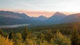 Smoke filled Sunset over Lower Two Medicine Lake in Glacier National Park in Montana USA durng the 2017 fall fires stock image