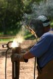 Smoke and fire. Welder welding on steel Royalty Free Stock Image