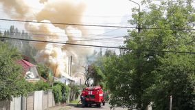 Smoke from fire and fire truck. KIEV, UKRAINE - 07 18 2017 Smoke from fire and fire truck, fire extinguishing with water stock video