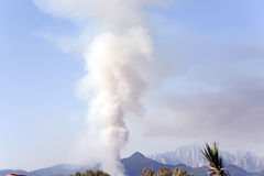 Smoke from a fire in the mountains Stock Image