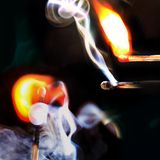 Smoke and fire. And a black background Royalty Free Stock Photography