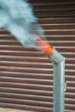 Smoke and fire in the tube Royalty Free Stock Photography