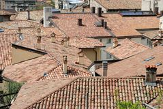 Smoke fireplaces. Roofs and chimneys of the old town stock images