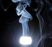 Smoke flare. Blue smoke rising from the flash Stock Image