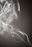 Smoke flows from an aromatic stick Royalty Free Stock Images