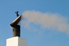 Smoke and flue draft. Smoke coming out of a chimney Royalty Free Stock Images