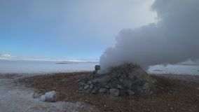 Smoke and Fog Filled Landscape in Iceland. Hverir and Myvatn geothermal area in north of Iceland during winter time and snowy lands. Fog or smoke coming out of stock video