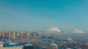 Smoke and fog over the city. Of Novosibirsk on a frosty sunny day, timelapse stock video