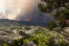 Smoke from a forest fire. Smoke billows over the mountain at the High Park forest fire in Fort Collins Colorado Royalty Free Stock Image