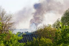 Forest fire view from afar. Smoke of a forest fire from afar in the countryside Royalty Free Stock Photos