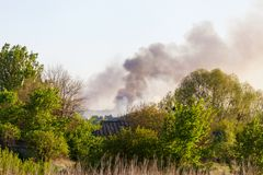 Forest fire view from afar. Smoke of a forest fire from afar in the countryside Royalty Free Stock Photo