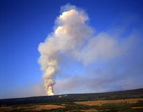 Smoke from Forest Fire (H). The smoke from a forest fire, on the other side of a hill stock photo
