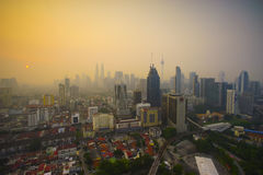 Smoke from forest fires in Indonesia blows across the Malay Peni Stock Photo