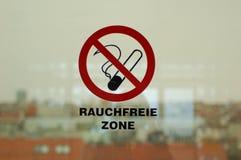 Smoke free zone. Smoking prohibited sign on a hospital window in Vienna, Austria : Rauchfreie Zone - smoke free zone Royalty Free Stock Photo