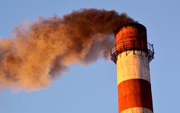 Smoke fromthe boiler house pipe. Image of smoke and chimney against the sky Stock Image