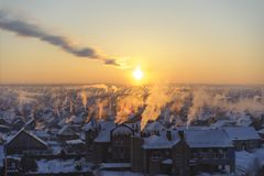 Smoke at the frosty sunset.  royalty free stock photography