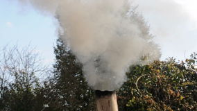 Smoke funnels out of chimney stock video footage