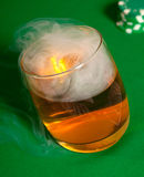 Smoke in a glass with a drink. Royalty Free Stock Photos