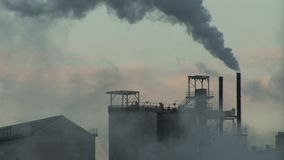 Smoke going into the atmosphere heavy industry. England and industrial landscape with smoking chimney heavy industry stock footage