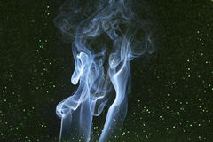 Smoke on green dotted black background Stock Photos