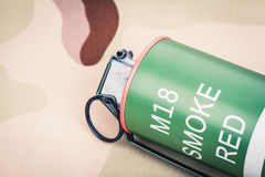 Smoke grenade red color M18,frag explosion Royalty Free Stock Photos