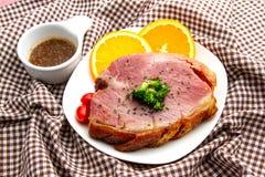 Smoke Ham. With gravy and slice orange Stock Photos